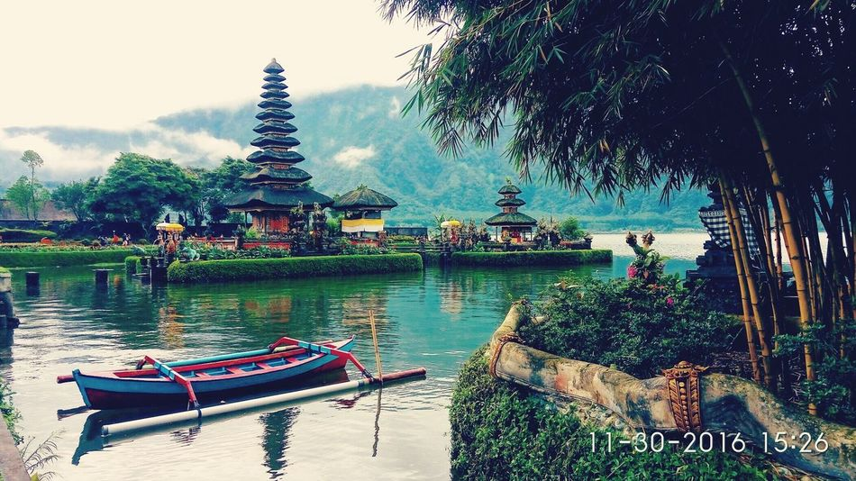 Ulundanu beratan lake temple located in the wast bali island about 1200 meter from sea level , one of the beautiful temple in bali dedicated to the god of dewi danu blessing to the farmers Architecture Travel Destinations Place Of Worship Religion Lake Ulundanuberatan Bali Temples bali island