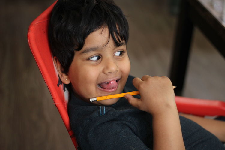 Portrait of smiling boy in chair