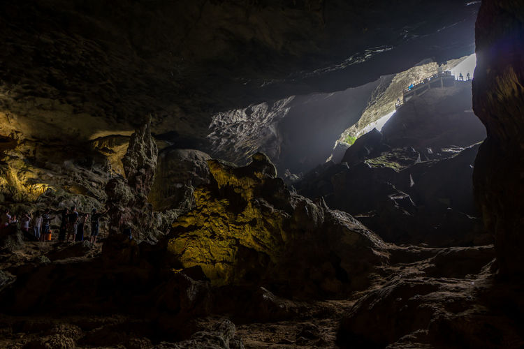 Cave at Ha Long Bay, Vietnam Beauty In Nature Cave Day Geology Low Angle View Nature No People Non-urban Scene Outdoors Physical Geography Power In Nature Rock Rock - Object Rock Formation Scenics - Nature Solid Tranquil Scene Tranquility Travel Destinations Water