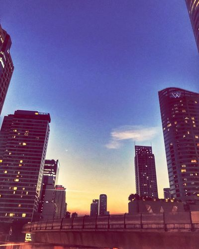 Architecture Building Exterior Skyscraper Built Structure City Low Angle View Development Sunset Blue Urban Skyline Downtown District City Life Cityscape Sky