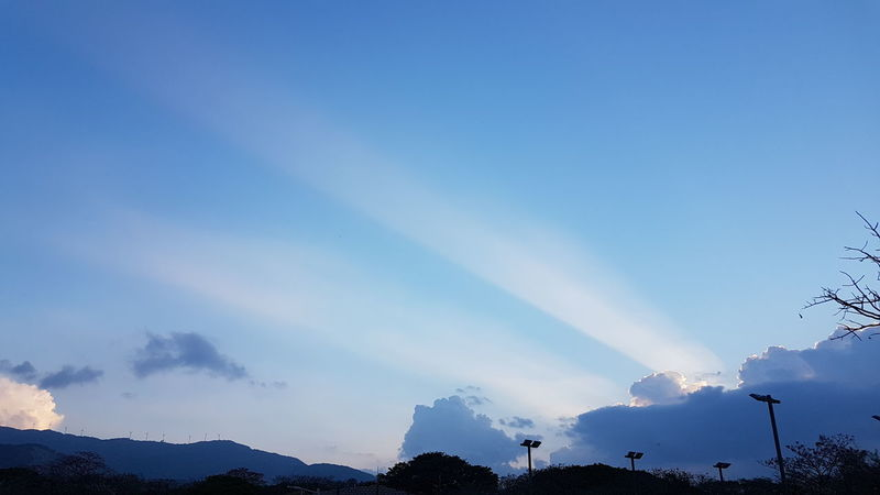Check This Out Sky Blue Outdoors Sunbeam Sunset Magestic Sky Tranquility Costa Rica❤ Dramatic Sky Silhouette Trees Trees And Sky