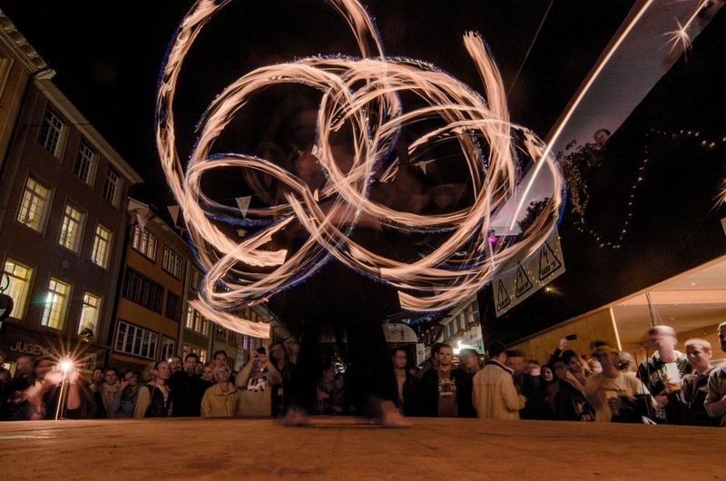 Chispa Firedancers in a crowd during Musikfestwochen in Winterthur Mfw Musikfestwochen Festival Chispa Fire Firedance Firedancer City Crowd Illuminated Performance Fame Nightlife Arts Culture And Entertainment Motion Blurred Motion Astronomy
