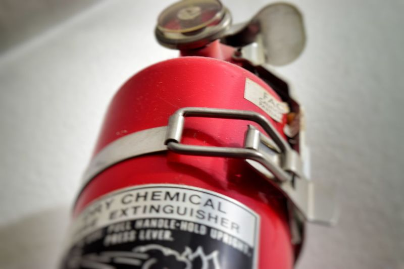 Fire Extinguisher Red Close-up No People Indoors  Safety Hazard Prevention Carbon Dioxide Water Home Office Kitchen Quick Release Buckle Simple Macro Vignetting H&s Health Stock Chemical Wall Mounted