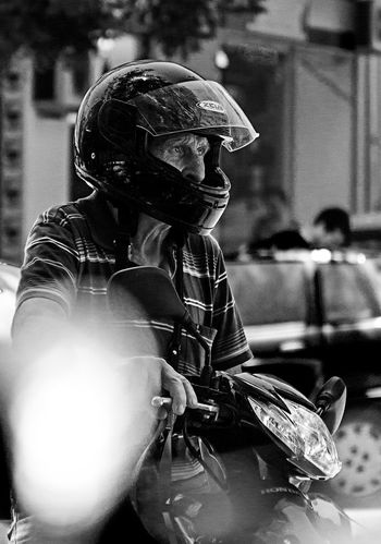 Bike Blackandwhite Bokeh Photography Canon Casual Clothing Close-up Contrust Day Focus On Foreground Helmet Leisure Activity Lifestyles Older Man Portrait Selective Focus Up Close Street Photography