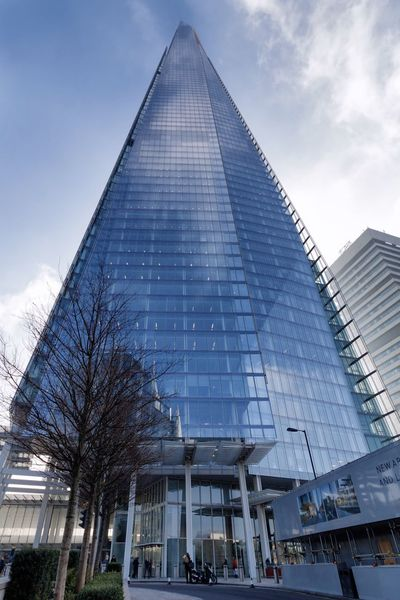 the Shard in London Architecture Building Exterior Built Structure City Cloud - Sky Day London Londonarchitecture Londoncity Low Angle View Modern No People Outdoors Pyramid Shadow Sky Skyscraper Theshard Theshardlondon Travel Destinations