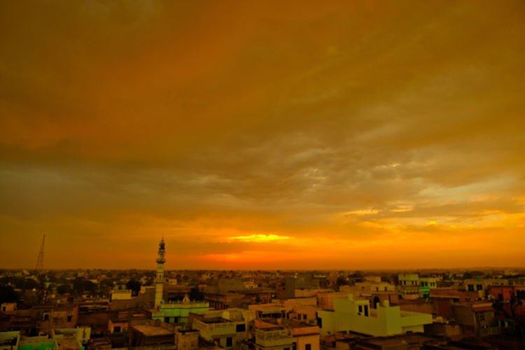 Sunset over old town old Mandawa, India. ASIA India Mandawa, Rajasthan Old Town Architecture Beauty In Nature Building Building Exterior Built Structure City Cityscape Cloud - Sky Dramatic Sky High Angle View Mandawa Nature No People Old City Orange Color Outdoors Residential District Romantic Sky Sky Sunset Town TOWNSCAPE