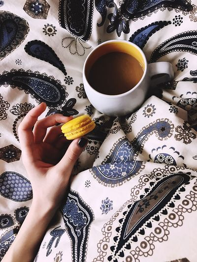 Human Hand One Person Lifestyles Holding Human Body Part One Woman Only Human Finger Food And Drink Tea Cup Real People Personal Perspective Indoors  Women Leisure Activity Adults Only Tea - Hot Drink Adult Only Women People Domestic Life Macarons Breakfast Coffee Dessert