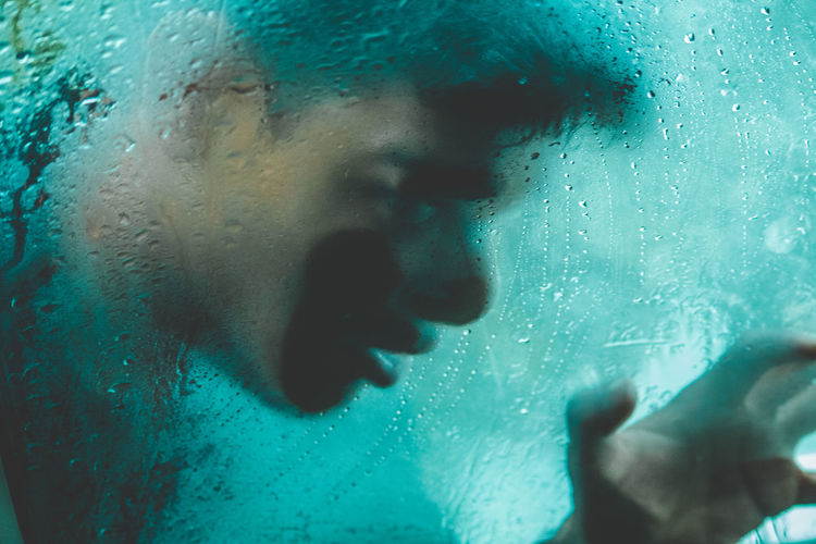 Close-up Condensation Drop Glass Glass - Material Headshot Human Body Part Human Hand Indoors  Lifestyles Men Nature One Person Portrait Rain Real People Transparent Water Wet Window