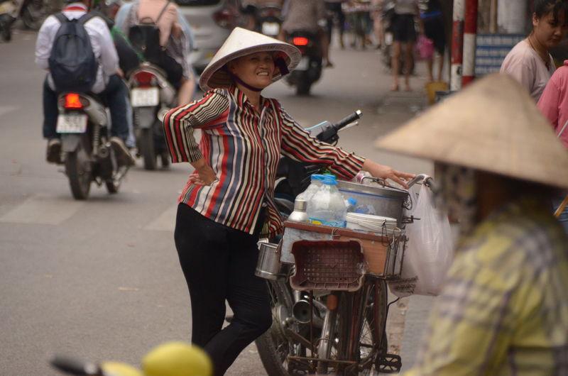 Vietnamese seller in hanoi with her bike