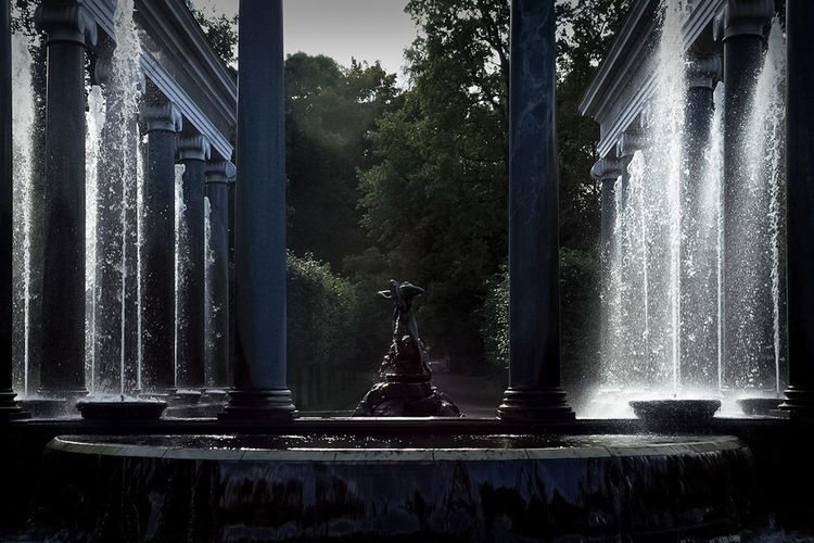 Water fountain in park against building