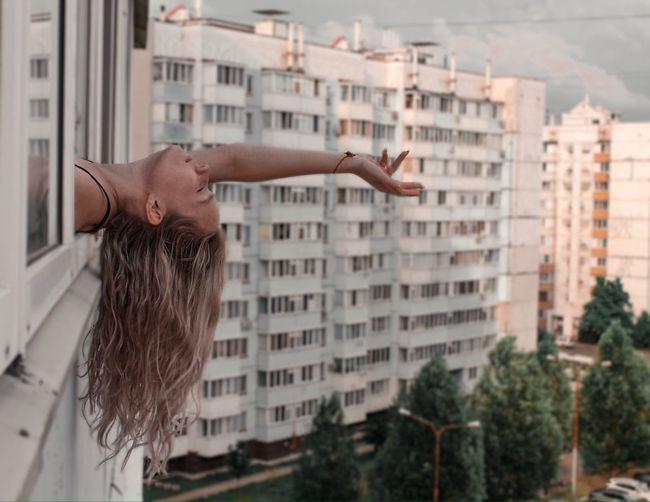 Woman with head outside window
