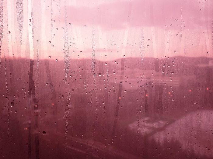 Full Frame Shot Of Wet Glass Window