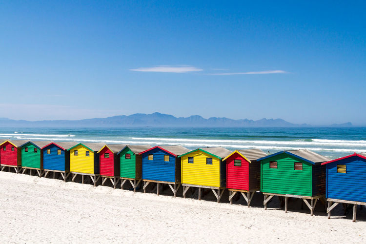 Multi Colored Beach Huts On Beach