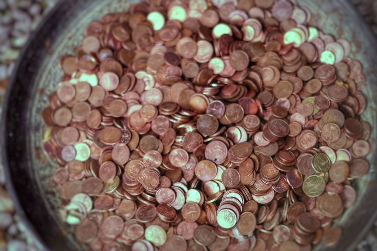 High angle view of coins in container