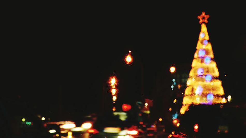 The Christmas Decoration Celebration Christmas Lights Christmas Tree Illuminated Night Christmas City Public Transportation Outdoors Transportation City Exploring The City Streets No People Night Photography Urban Exploration Cascais, Portugal Christmas Lights!  Night Street Photography Inside The Car Motion Blur Blur Motion Blurred Motion Christmas Lights!  Blurred Lights Adapted To The City