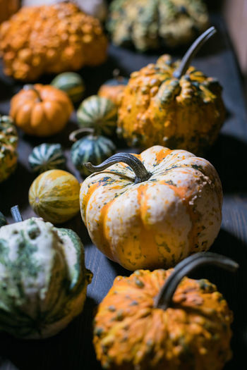 High angle view of pumpkins on table at market
