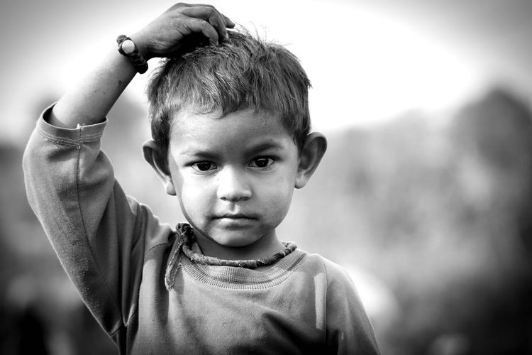 Portrait Of Boy With Hand In Hair
