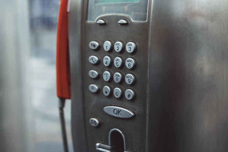 Close-up of telephone in booth