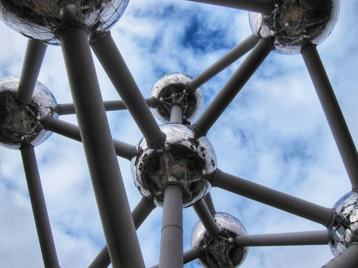 Atomiumbruxelles Atomium Low Angle View Metal Day Sky No People Outdoors Nature Built Structure Cloud - Sky Architecture Arts Culture And Entertainment