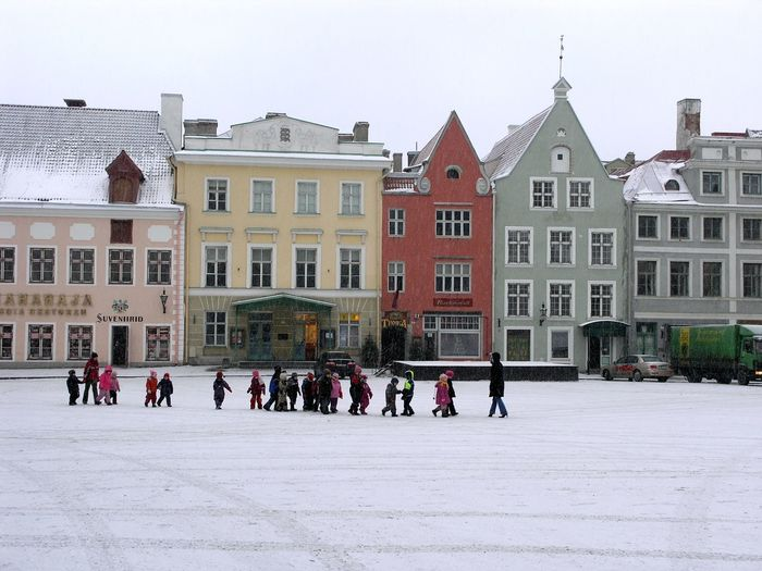 Group of people in front of buildings in city