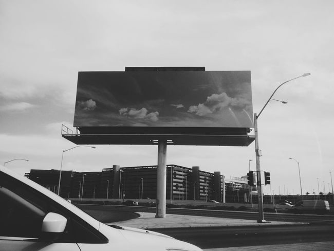 Evanscsmith Photographerinlasvegas Sky Outdoors Day Blackandwhite Photography Architecture Silhouette Airport Billboard Billboardsky Blackskys