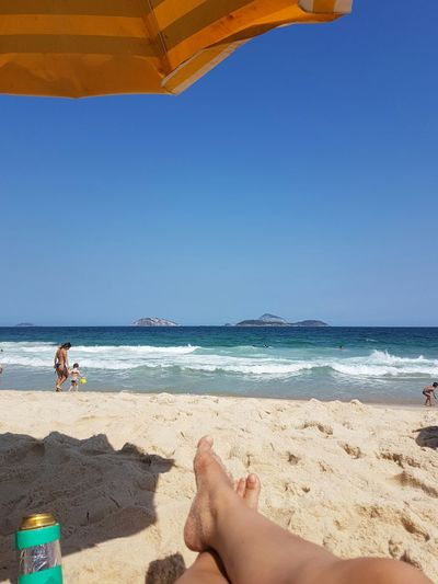 Beach Sea Sand Relaxation Vacations Clear Sky Barefoot Horizon Over Water Water Scenics Blue Relaxing Leisure Activity Tranquil Scene Tourist Rio De Janeiro Ipanema Beach Ipanema RJ Brasil Brazil Beach Sea Person Sand Low Section Relaxation