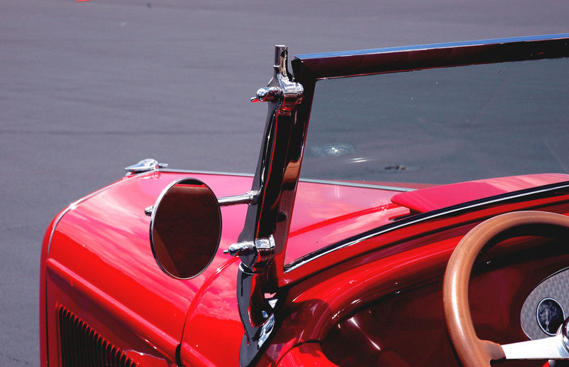 Close-up of red vintage car parked on road
