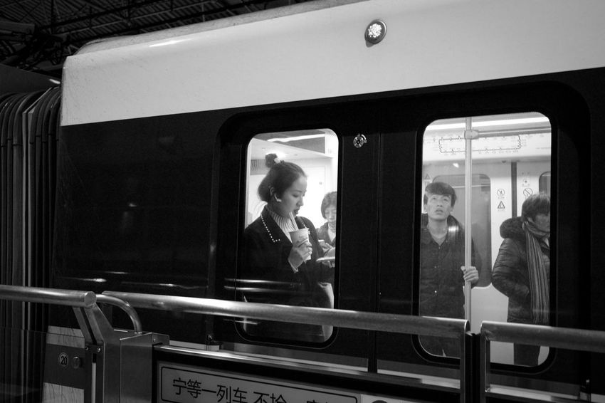 Glass - Material Reflection Mode Of Transportation Public Transportation Real People Transportation Lifestyles Window People Rail Transportation Transparent Standing Leisure Activity Indoors  Looking Railing Front View Women Train Subway Train Blackandwhite