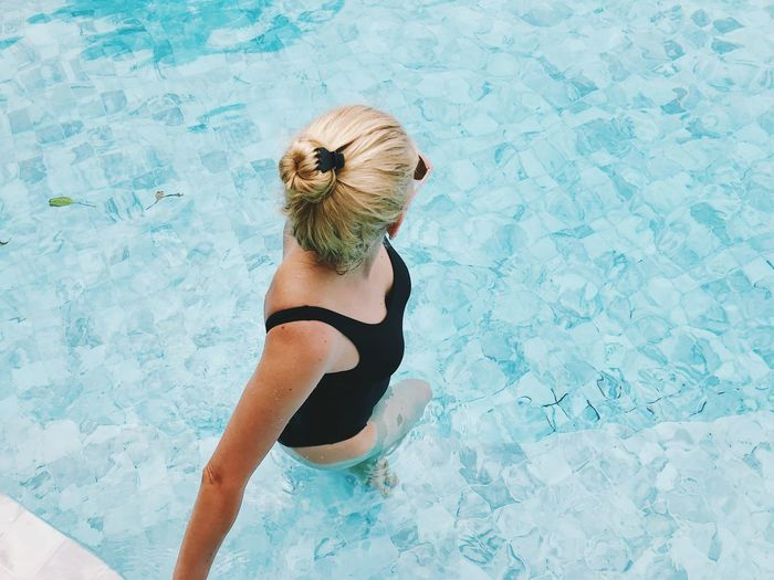Swimming Pool Pool Lifestyles One Person Leisure Activity Real People Women Water High Angle View Swimwear Hair Young Adult Blond Hair Young Women Rear View Adult Blue Hairstyle Outdoors Turquoise Colored