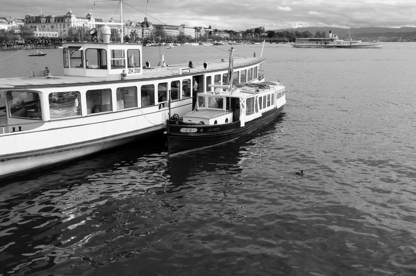 Black & White Harbor Beauty In Nature Black And White Cloud - Sky Darkness And Light Fujifilm_xseries High Contrast Incidental People Lake Lake View Lake Zürich Mode Of Transport Monochrome Moored Motor Boat Nature Nautical Vessel Outdoors Red Filter Transportation Travel Destinations Water Waterfront