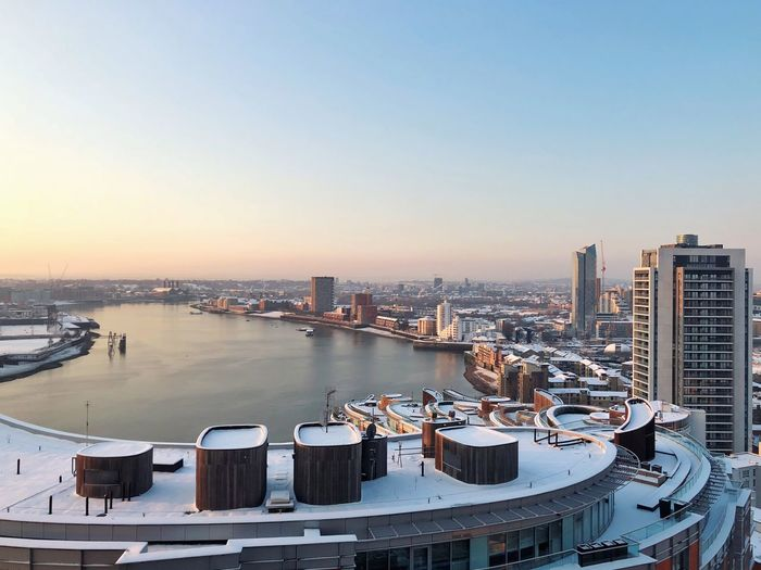 View of River Thames from Canary Wharf Morning View Tranquility River View Overnight Snow City View  Canary Wharf London River Thames Architecture Building Exterior Built Structure Water Clear Sky No People Outdoors Cityscape