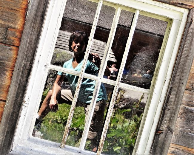 Alps Day Lifestyles One Person Outdoors Real People Reflection Reflexions Window