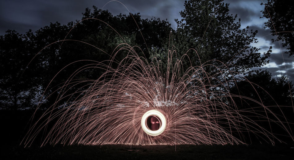 Abstract Circle Dark Fire Illuminated Landscape Lightpainting Lightpaintingphotography Night Photography Outdoors Sparks Sparks Fly