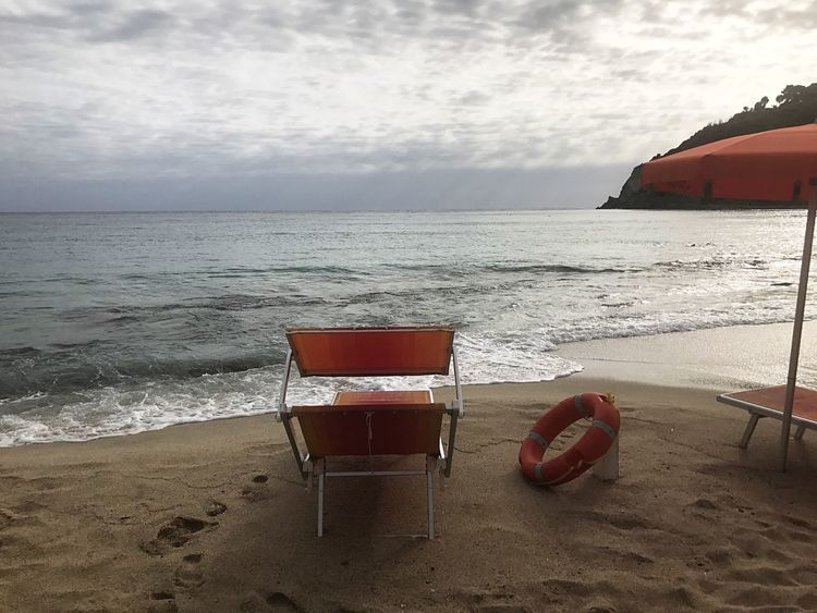 Sea Beach Horizon Over Water Sand Water Chair Nature Sky Absence No People Beauty In Nature Tranquility Scenics Day Red Outdoors