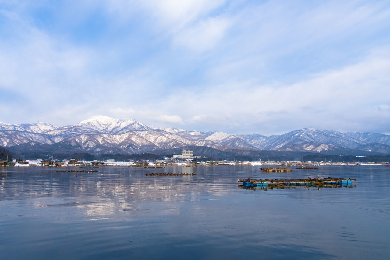 mountain, mountain range, water, beauty in nature, scenics, nature, tranquility, waterfront, tranquil scene, snowcapped mountain, cold temperature, winter, day, lake, snow, sky, outdoors, cloud - sky, no people, blue, iceberg, nautical vessel