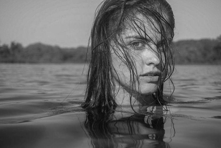 Portrait of woman in lake