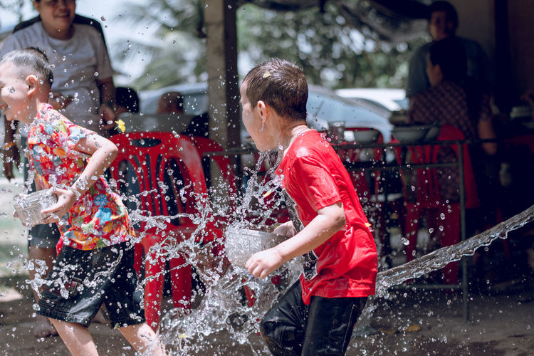 Child Day Fun Lifestyles Men Motion Outdoors Real People Red Water