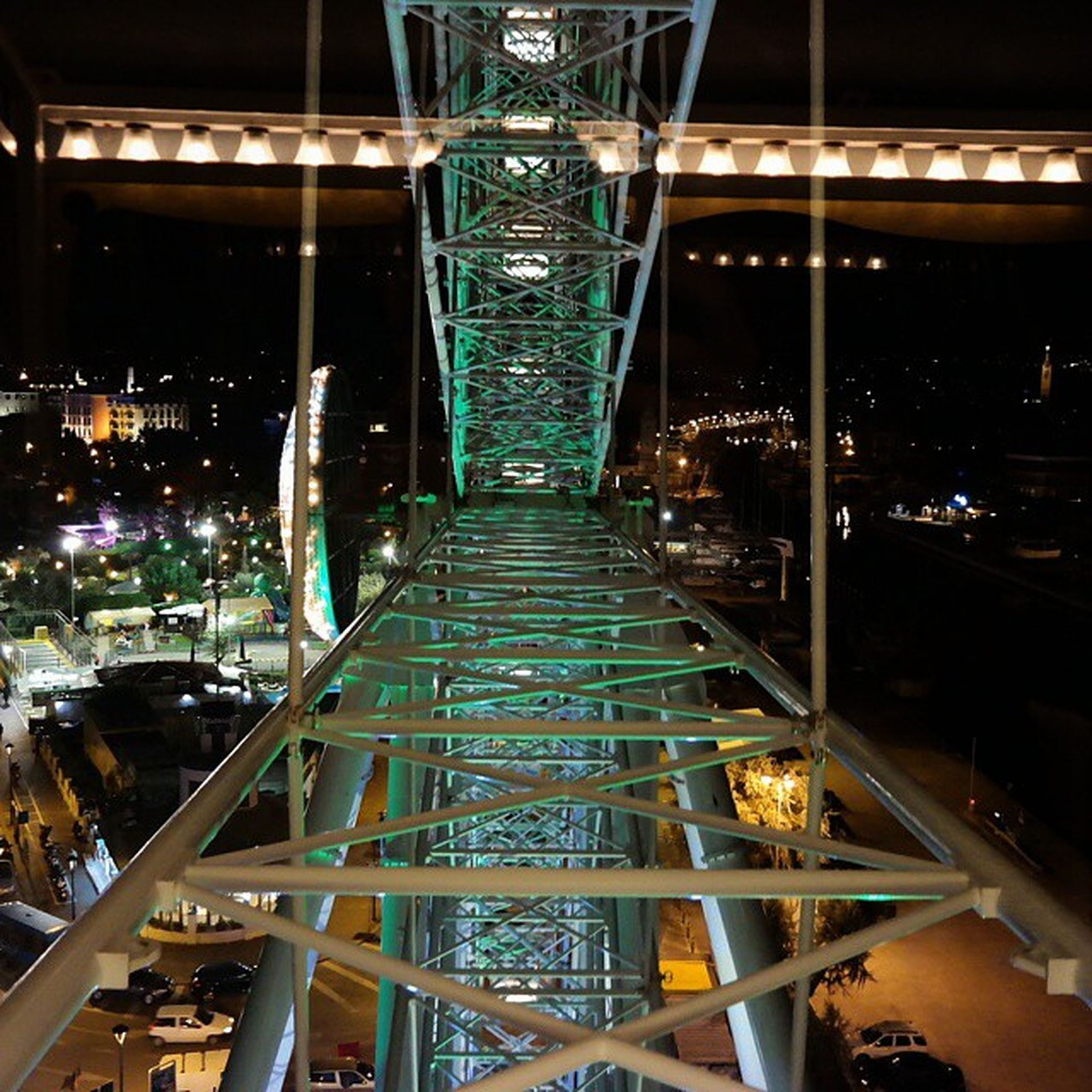built structure, architecture, night, illuminated, metal, transportation, building exterior, the way forward, diminishing perspective, city, railing, no people, bridge - man made structure, indoors, engineering, vanishing point, high angle view, connection, metallic