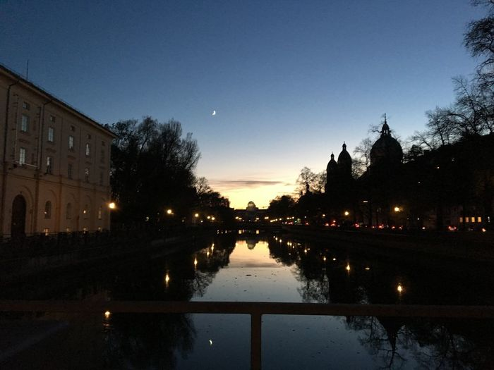 Isar in München zur blauen Stunde an der Praterinsel Blue Hour Cityscape Architecture Reflection Sky Water Built Structure Building Exterior Tree Illuminated City Sunset Building Clear Sky Silhouette Outdoors