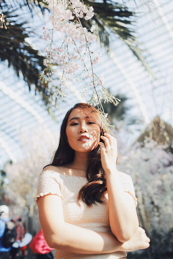 My Best Photo International Women's Day 2019 Streetwise Photography One Person Real People Leisure Activity Lifestyles Young Women Young Adult Front View Looking At Camera Portrait Plant Day Women Hair Hairstyle Long Hair Casual Clothing Focus On Foreground Tree Beautiful Woman Outdoors Contemplation