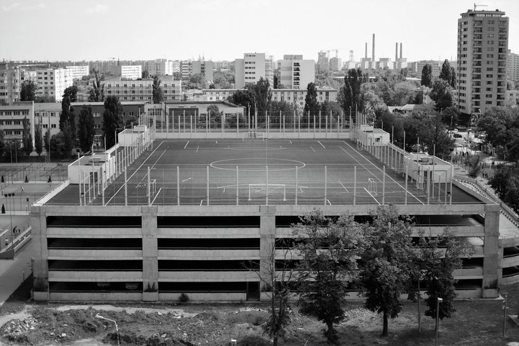 Architecture Black And White Photography Building Exterior Built Structure City Cityscape Day Football Field Horizontal No People Outdoors Sky Tree Urban Scene Monocrome Photography