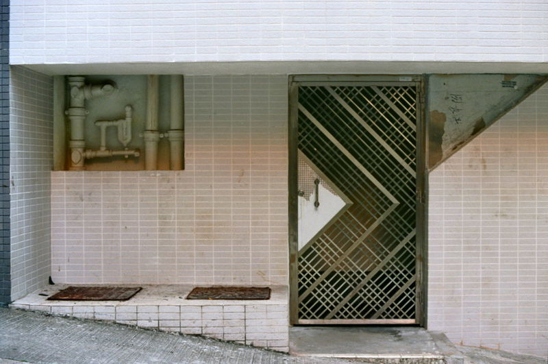 Entrance to apartment with metal screen door