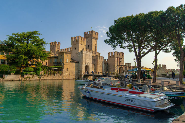 A wonderful view on Rocca Scaligera in Sirmione, Italy Laky Architecture Building Exterior Built Structure City Day Fortress Garda Italy Medieval Mode Of Transportation Outdoors Plant Sirmione Sky Transportation Travel Travel Destinations Tree Water Waterfront Yacht
