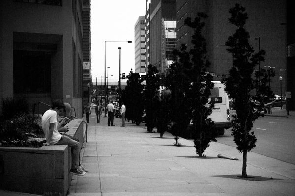 Architecture Blackandwhite Building Exterior Casual Clothing Cellphone City City Life City Street Day Distraction Leisure Activity Lifestyles Outdoors Walkway Streetphotography Street Photography Downtown Denver Colorado