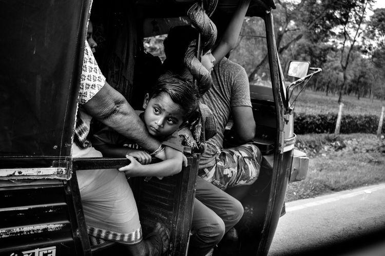 People sitting in rickshaw