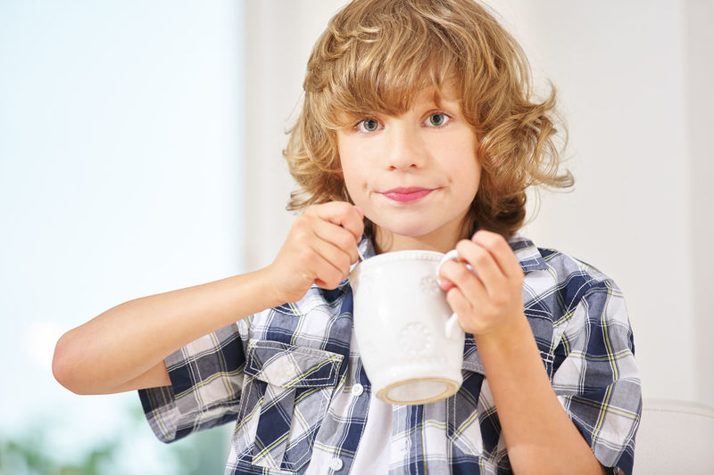 Portrait Of Boy Holding Cup