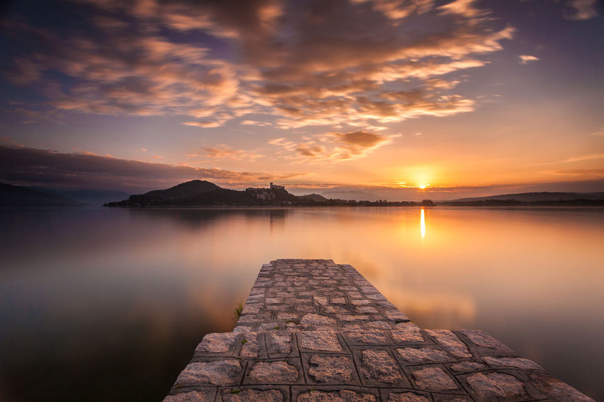 Sunrise in Arona Arona Lago Maggiore Beauty In Nature Clouds And Sky Italy Lake View Lakeside Landscape Mountain Nature No People Piedmont Italy Reflection Scenics Sunrise Tranquil Scene Tranquility Water