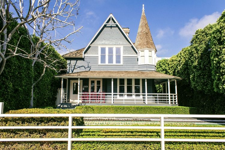 California, odd house on Santa Monica Blvd Architecture Window Tree Built Structure Building Exterior No People Day Outdoors Sky Light Tranquil Scene Blue Green House Landscape Hedges