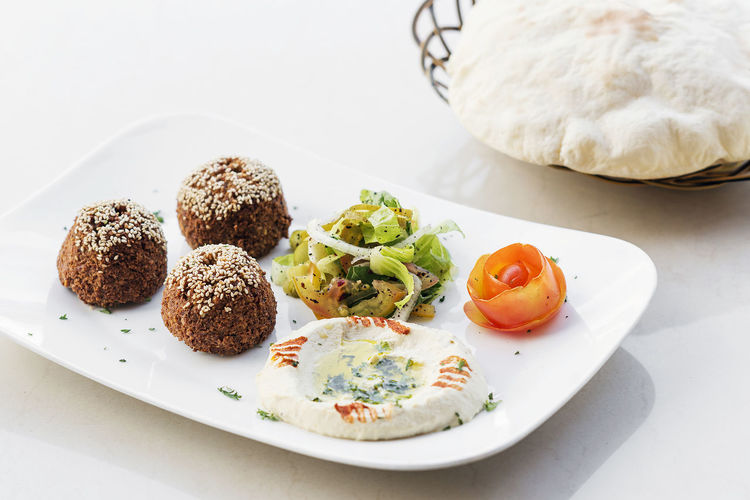falafel and hummus snack Falafel Lebanese Food Meze Mezze Snack Tapas Vegetarian Close-up Food Food And Drink Freshness Healthy Eating Houmous Hummus Lebanese Middle Eastern Food No People Plate Platter Ready-to-eat Set Meal
