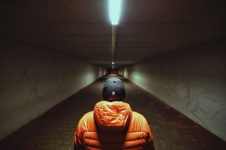 City Night Tunnel Wide Angle Orange Jacket Illuminated Street Photography